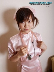Sexy asian nurse in pink dress