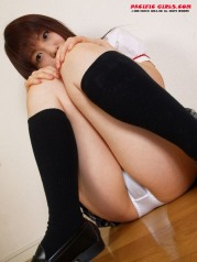 Schoolgirl in black socks legs expand