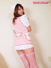 Asian nurse in a short skirt stretches the vagina