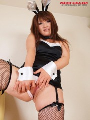 Female rabbit in black stockings takes off panties