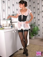 Housewife in the kitchen shows striptease