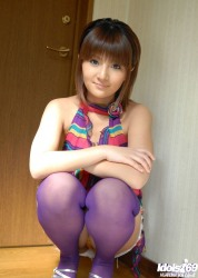 Gorgoeus Japanese Babe shows her Sexy Legs and Purple Stockings