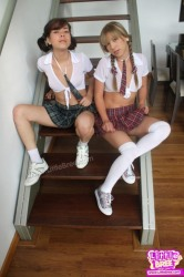 Two teen coed gets very horny in sexy uniform