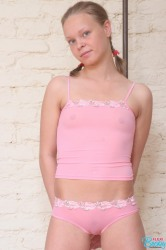 Cute teen girl in pink skirt
