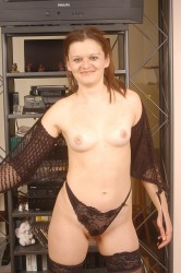 Redhead In Stockings Undresses Shows Hairy Pussy