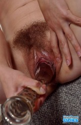 Hairy Brunette With Small Tits Toying On Bed