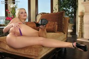 Gorgeous blonde beauty Alexis Texas wearing a sexy purple nightie