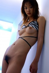 Tall And Young Japanese Girl Izumi Strips And Shows Her Hairy