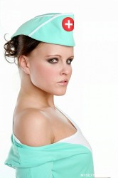Dark Haired Nurse In Stockings Undresses Poses