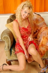 Enticing Curly Haired Blonde Anilos Shows Off Her Perky Mature