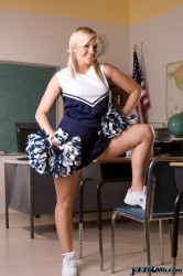 Sexy cheerleader girl in blue skirt and white panty