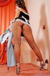 Redhead maid Caroline demonstrates hot ass in fishnet pantyhose during ironing