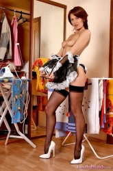 Redhead maid Lilly showing class ass and hot legs in black stockings