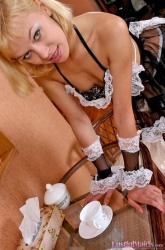 Delicious maid shows her nude intimate places