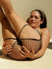 Rebekah Dee Takes Off Her Fishnet Bikini To Masturbate