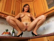 Sexy Brunette In The Kitchen Playign With Her Pussy