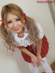 Sexy japan schoolgirl in red skirt and white socks