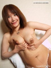 Asian girl stretches pink pussy