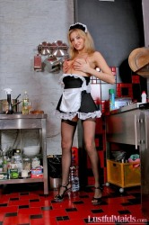 Cute blonde maid Secilia washing the dishes in the kitchen