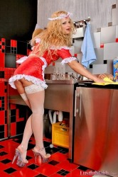 Horny blonde maid Kristal posing in white stockings and red outfit at kitchen