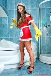Brunette maid Maria posing at bathroom with her red fishnet pantyhose