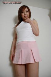 Asian girl in a pink skirt takes off her panties