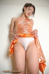 Asian girl in orange dress stretches the vagina