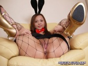 Bunny in black pantyhose stretches vagina